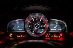 Modern car instrument dashboard panel or speedometer Stock Photos