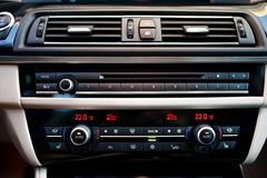 Modern car interior with close-up of air conditioning Stock Photos