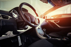 Modern car interior dashboard and steering wheel.  Royalty Free Stock Photos