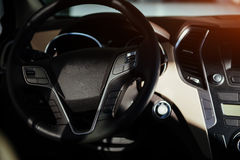 Modern car interior dashboard and steering wheel. Modern car interior dashboard and steering wheel Stock Photography