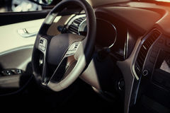 Modern car interior dashboard and steering wheel.  Royalty Free Stock Image
