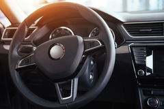 Modern car interior dashboard and steering wheel.  Stock Images