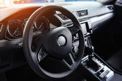 Modern car interior dashboard and steering wheel.  Royalty Free Stock Photography