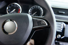 Modern car interior dashboard and steering wheel.  Stock Photo