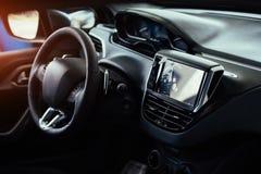 Modern car interior dashboard and steering wheel.  Stock Photos
