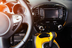 Modern car interior dashboard and steering wheel Stock Images