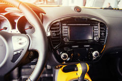 Modern car interior dashboard and steering wheel Royalty Free Stock Image