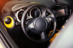 Modern car interior dashboard and steering wheel Royalty Free Stock Photo