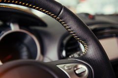 Modern car interior dashboard and steering wheel Royalty Free Stock Photography