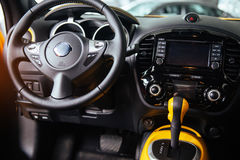 Modern car interior dashboard and steering wheel.  Stock Image