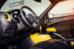 Modern car interior dashboard and steering wheel Royalty Free Stock Images