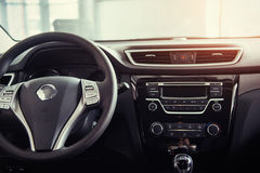 Modern car interior dashboard and steering wheel.  Royalty Free Stock Images
