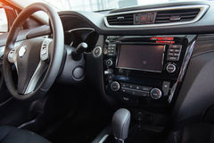 Modern car interior dashboard and steering wheel.  Royalty Free Stock Photo