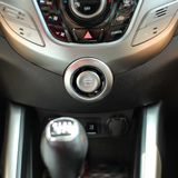 Modern car interior with engine start stop button in focus stock image