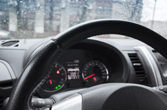 Modern car interior fragment with steering wheel. And control panel Royalty Free Stock Image