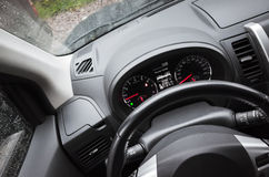 Modern car interior fragment with steering wheel. And control panel, driver view point Royalty Free Stock Photo