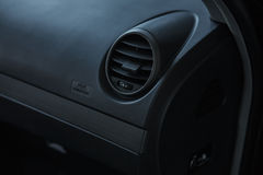 Modern car interior, passenger airbag and air conditioning hole. Stock Photo