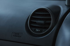 Modern car interior, passenger airbag and air conditioning hole. Royalty Free Stock Image
