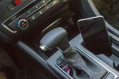 Modern car interior with smart phone Royalty Free Stock Photo