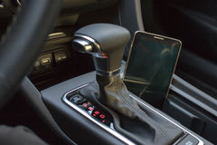 Modern car interior with smart phone Stock Photography