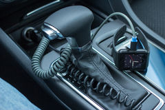 Modern car interior with smart watch on gear stick. Royalty Free Stock Image
