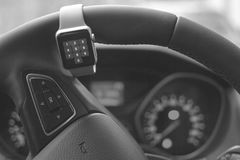 Modern car interior with smart watch on steering wheel Stock Photo