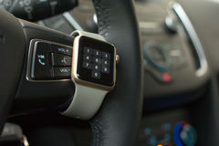 Modern car interior with smart watch on steering wheel Royalty Free Stock Image