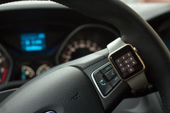 Modern car interior with smart watch on steering wheel Stock Photos