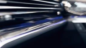 Modern car interior. Soft focus. Modern car illuminated dashboard. Luxurious car instrument cluster. stock image