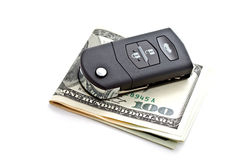 Modern car key with banknotes Stock Images