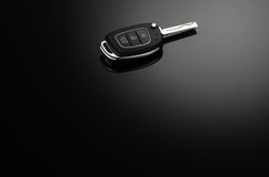 Modern car keys isolated on black reflective background Royalty Free Stock Images
