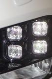 Modern car lights. Close up detail of modern car head lights Stock Photo