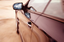 Modern car in motion Royalty Free Stock Image