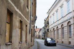 Modern car in narrow paved street Stock Photo