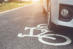 Modern Car Running On Asphalt Road / Bicycle Lane And Tread On W Royalty Free Stock Photo