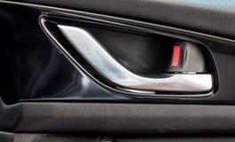 Modern car's door opening handle and door lock Royalty Free Stock Images