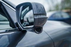 Modern car side mirrors with indicator built in honda lane watch camera. Grey sedan foldable side mirror external with built in indicator slit and camera for Stock Image