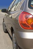 Modern car side-view. Modern car rear side-view varnished with reflection on side Royalty Free Stock Photos