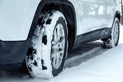 Modern car on snowy road, closeup view. Winter season stock image