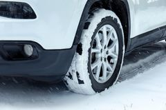 Modern car on snowy road, closeup view. Winter season stock images