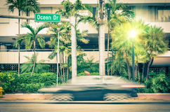 Modern car speeding along Ocean Drive in Miami Royalty Free Stock Photos