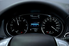 Modern car speedometer and illuminated dashboard Stock Photo