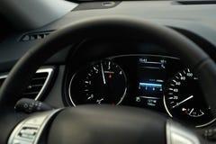 Modern car speedometer and illuminated dashboard Royalty Free Stock Photos