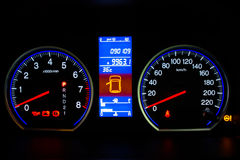 Modern Car Speedometer and Illuminated Dashboard Royalty Free Stock Photos