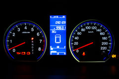 Modern Car Speedometer and Illuminated Dashboard Stock Image