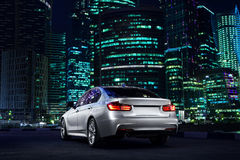 Modern car stand near Moscow City district at night Stock Image