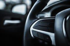 Modern Car Steering Wheel. Closeup Photo. Function Buttons on the Wheel Stock Photos
