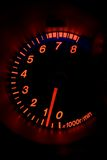 Modern car tachometer. A modern car tachometer, isolated on black. The gauge reads that the car is in idle Royalty Free Stock Image