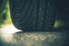 Modern Car Tire on the Road. Closeup Photo. Summer Season Pneumatic Tire on a Paved Road Royalty Free Stock Image