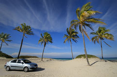 Modern car on tropical beach Royalty Free Stock Images